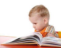 Sad baby with book Stock Image