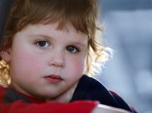 Sad baby boy. A close-up of a cute sad baby boy stock photo