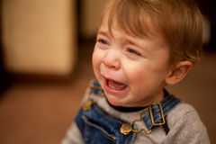 Sad baby boy crying at home Royalty Free Stock Photo