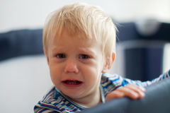Sad baby in the crib Royalty Free Stock Photography