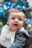 Sad baby cries to christmas Stock Photography