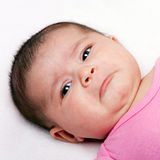 Sad baby expression. Cute baby with sad expression. Infant with curled lip making faces stock images