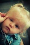 Sad baby girl stock image