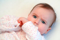 Sad baby girl looking at camera. Close up Stock Photo