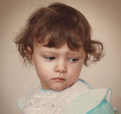 Sad baby girl looking down. Closeup Stock Photos