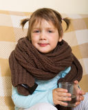 Sad baby girl in warm scarf Royalty Free Stock Photos