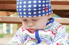 Sad baby outdoors. Sad baby age of 10 months outdoors Royalty Free Stock Images