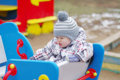 Sad baby on playground Royalty Free Stock Photos