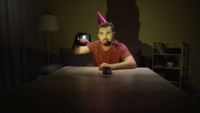 Sad bachelor celebrating birthday alone making selfie, depression, single life
