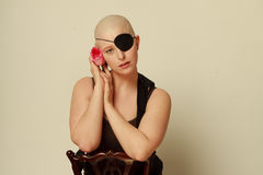 Sad bald girl with eye patch and Rose Royalty Free Stock Photography