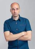 Sad bald man looking away. Studio shot Stock Photos
