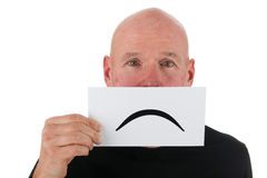 Sad bald man with smiley Stock Photo