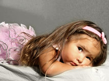 Sad Ballerina. Young girl in her ballerina outfit - looking sad Stock Photo