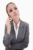 Sad bank employee on her cellphone Stock Photos