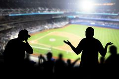 Sad baseball fans in stadium. Disappointed, angry and upset crowd in ballpark. Favourite team lost game. Devastated audience in live sport event. Angry stock photos