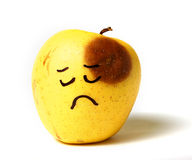 Sad beaten black eye fake apple Stock Photo