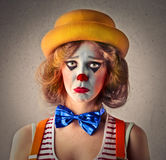 Sad beautiful clown Stock Images