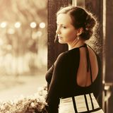 Sad beautiful fashion woman with bun updo hair standing on porch stock images