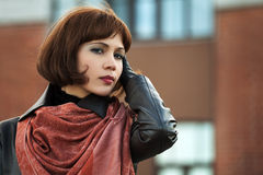 Sad beautiful fashion woman in leather coat outdoor Royalty Free Stock Photos