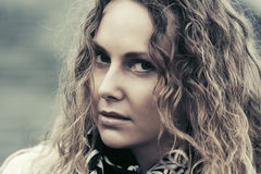 Sad beautiful fashion woman with long curly hairs Royalty Free Stock Image