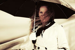 Sad beautiful fashion woman with umbrella outdoor Royalty Free Stock Photo