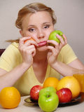 Sad beautiful girl with fruit Royalty Free Stock Image