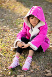 Sad beautiful little girl in pink coat Royalty Free Stock Photography