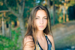 Sad beautiful pretty lady with long hair outdoors Royalty Free Stock Image