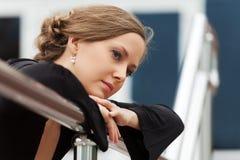 Sad beautiful woman daydreaming Royalty Free Stock Photos