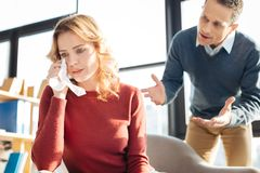 Sad beautiful woman feeling overwhelmed by emotions. Too much stress. Sad unhappy beautiful women crying and feeling overwhelmed by emotions while suffering from Stock Photo
