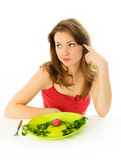 Sad beautiful woman keeping a diet Royalty Free Stock Photo
