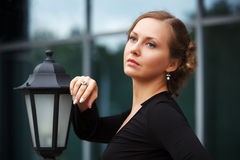Sad beautiful woman at lamppost Royalty Free Stock Photo