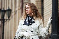 Sad beautiful woman at lamppost Stock Photo