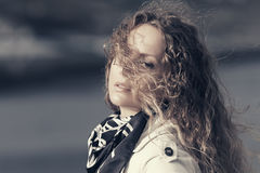 Sad beautiful woman with long curly hairs outdoor Stock Photo