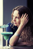Sad beautiful woman with long curly hairs Royalty Free Stock Photo