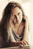 Sad beautiful woman with long curly hairs Stock Photo