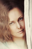 Sad beautiful woman looking out window Stock Photography