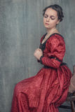 Sad beautiful woman in medieval dress stock images