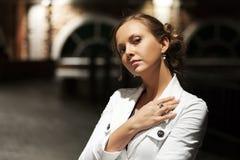 Sad beautiful woman on the night street Royalty Free Stock Photography