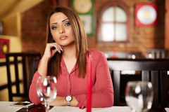 Sad beautiful woman in a restaurant Royalty Free Stock Photo