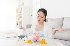 Sad beautiful woman want to buy new house. For family but her fund not enough and making helpless posing looking at savings feeling depressed Stock Photography