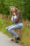 Sad beautiful young woman sitting Royalty Free Stock Photos