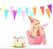 Sad birthday girl with a cake Royalty Free Stock Photo