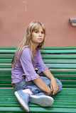 Sad blond lonely teen girl sitting Royalty Free Stock Images