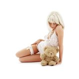 Sad blond with teddy bear Stock Images