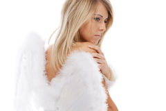 Sad blonde angel posing on white Stock Photo