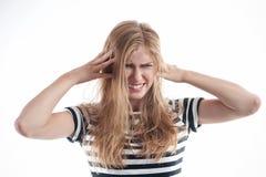 Sad blonde girl having headache Stock Images
