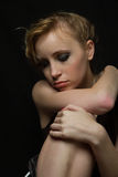 Sad blonde looking aside, , black background Royalty Free Stock Photography