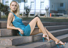 Sad blonde in turquoise dress Royalty Free Stock Photo