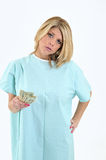 Sad blonde woman patient in hospital gown Royalty Free Stock Images